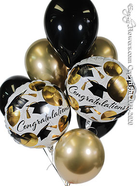 Six latex balloons in gold and black with two white round foil balloons printed with a congratulations message in cursive and printed gold balloons and graduations hats available for delivery by Avante Gardens located in Santa Ana, California