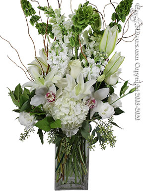 Ivory Floral - All White Flowers Arranged In A Block Glass Vase